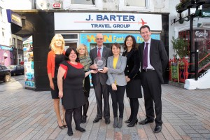 REPRO FREE 14/10/15 George Barter of the  J. Barter Travel group photographed with the Cork Business Association 3rd Quarter Medium Business of the Year Award with Tom Randles MD and staff members Janet Quinlan, Caroline Kelly, Katarina Trnikova, Niamh O'Donovan and Sarah Brady. Photo: Billy macGill