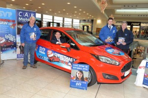 REPRO FREE 03/12/2015 Justin Young (Manager Mahon Point SC) behind the wheel of the Ford Fiesta which will be raffled this Christmas in aid of St. Vincent de Paul which is on display at Mahon Point Shopping Centre. Also included are Brendan O'Neill (SVP Chairman of the Fundraising Group), Seamus Harnedy (CAB Motors Ambassador) and Donal Whooley (SVP Northside Area President). Photo: Billy macGill
