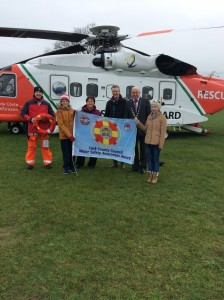 Deputy Mayor of the County of Cork, Cllr Kevin O'Keeffe joins Caroline Casey, Cork County Council and Rescue 117 Coast Guard Helicopter Crew to present the Water Safety Awareness Flag to Castlelyons National School students together with their Principal, Neilus de Roiste.