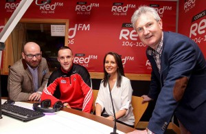 """REPRO FREE - NO REPRODUCTION FEE. 29/02/2016. Cork's RedFM reach agreement with GAA for additional reporting rights Launch, in the new RedFM Studio, at RedFM Studios, Curraheen Road, Cork. Pictured are Ruairi O'Hagan and Lisa Lawlor, Cork's RedFM The Big Red Bench with Stephen McDonnell, Cork Gaa Senior Hurling Captain and Kieran Kingston, Cork Gaa Senior Hurling Manager, in the new RedFM Studio. Picture: Jim Coughlan. Press Release: Cork's Red FM reach agreement with GAA for additional reporting rights. Immediate release In association with the Gaelic Athletics Association, Cork's Red FM is delighted to announce that it has secured additional access to, and reporting rights for all Cork GAA matches. The station had previously been permitted to enter locally hosted National League and Munster Championship fixtures, but will now receive full press accreditation for all games involving Cork GAA. The station will now be in a position to provide live on-air updates from games, and will have access to the post-match press conferences. This successful application is testament to the stations continued dedication to Gaelic Games coverage, consistent growth in on-air output and online activity, including the proud sponsorship of the Red FM Senior Hurling League.   Cork Senior Hurling and Football Captains, Stephen McDonnell and Paul Kerrigan, along with Hurling Manager Kieran Kingston and Football Selector Eoin O'Neill were on hand to help in the launch of this new deal. It comes ahead of a bumper weekend of Gaelic Games coverage this weekend where Cork's Red FM will provide updates from the National League double header featuring Cork versus Dublin on Saturday, before full coverage of the All Ireland Camogie Club Finals featuring Milford, at GAA Headquarters on Sunday. Commenting on the new Rights, Cork's Red FM CEO Diarmuid O'Leary has said """"Corks Red FM are delighted to be further extending our coverage of the inter-county teams for both men and women. We look fo"""